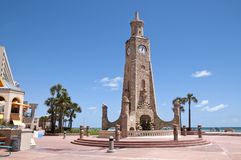 Stone Clock Tower. Daytona Beach has a beautiful stone clock tower to greet its guests and keeps them aware of the time Stock Images