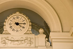 Stone clock under arch Stock Photo
