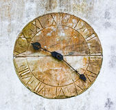Stone clock on a wall Stock Photo