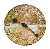 Stone clock on a wall against  white background Stock Photography