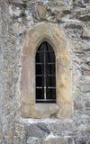 Stone close window with bars. Stone window with bars in England Stock Images