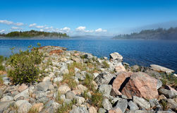 Stone coast. Of Ladoga and small fog over water Royalty Free Stock Images