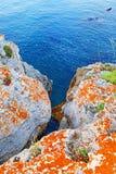 Colorful stone coast blue sea water Stock Photos
