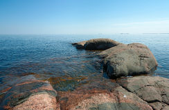Stone coast of Ladoga. Lake in a summer sunny day Royalty Free Stock Photos