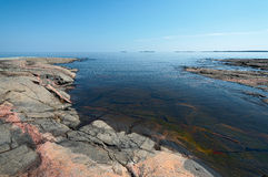 Stone coast of Ladoga. Lake in a summer sunny day Royalty Free Stock Photography