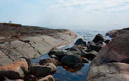 Stone coast of Ladoga. Lake in a summer sunny day Stock Photo
