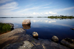 Stone coast of the lake. Stock Image