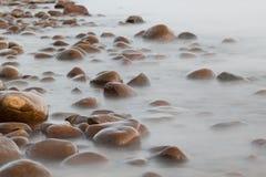 Stone coast near the sea Royalty Free Stock Images