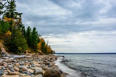 Stone coast in Pictured Rocks National Lakeshore, USA. Autumn fo. Stone coast in Pictured Rocks National Lakeshore, Munising, MI, USA. Autumn forest on the Stock Images
