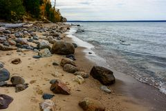 Stone coast in Pictured Rocks National Lakeshore, USA. Autumn fo. Stone coast in Pictured Rocks National Lakeshore, Munising, MI, USA. Autumn forest on the Royalty Free Stock Images