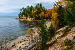 Stone coast in Pictured Rocks National Lakeshore, USA. Autumn fo. Stone coast in Pictured Rocks National Lakeshore, Munising, MI, USA. Autumn forest on the Royalty Free Stock Photography