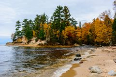 Stone coast in Pictured Rocks National Lakeshore, USA. Autumn fo. Stone coast in Pictured Rocks National Lakeshore, Munising, MI, USA. Autumn forest on the Stock Photo