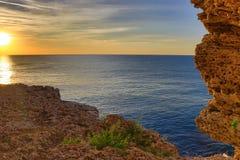 Stone coast sunrise Stock Image