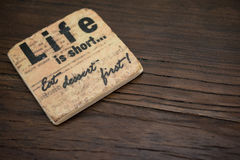 Stone Coaster on Table Royalty Free Stock Photography