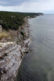 Stone coastline. Stony coastline on a cloudy day royalty free stock photography