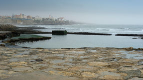 Stone coastline at Cascais, Portugal Royalty Free Stock Images