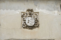 Stone coat of arms on the facade of an old building. Rock Royalty Free Stock Photo