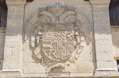 Stone coat of arms on facade old butchers building, Baeza, Jaen. Spain Stock Photography
