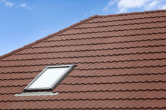 Stone Coated Metal tile Roof with skylight roof window. Stock Images