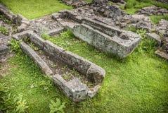 Stone Coffins. Monastic stone coffins found at Norton Priory, Cheshire Stock Images