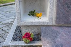 A stone columbarium. With an empty niche and without an urn royalty free stock photography