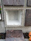 A stone columbarium. With an empty niche and without an urn royalty free stock photos
