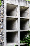 A stone columbarium with empty niches and power. An unoccupied stone columbarium with empty niches and power royalty free stock photos