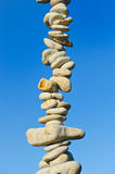 Stone column. Vertical pile from a sea pebble again Royalty Free Stock Photography