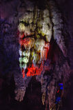 Stone column in YuHua cave, Fujian, South of China. Lighting and colorful stone column inside of YuHua Cave, a Karst cave, located in Taining, Fujian province Royalty Free Stock Image
