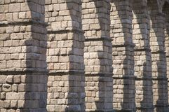 Stone columns. Roman aqueduct of segovia city in spain Royalty Free Stock Photo