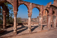 Stone columns and arches with patterns in an ancient palace Royalty Free Stock Image