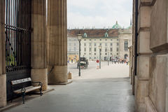 Stone columns and crowd of the tourists in historic centre of Vienna, UNESCO World Heritage Site Royalty Free Stock Photography