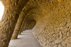 Stone columns in Park Guell Barcelona. Arcade of masonry stone columns in Park Guell Barcelona of Gaudi modernism Royalty Free Stock Photography