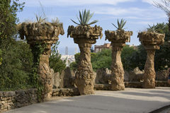 Stone columns with plants in park Guell, Barcelona. View on stone columns with plants in park Guell, Barcelona Stock Photography