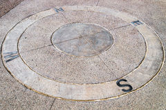 Stone compass on ground Royalty Free Stock Photography