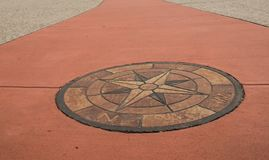 Stone compass rose in a walkway stock photos
