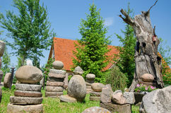 Stone composition in village in summer park Royalty Free Stock Photography