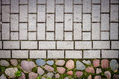Stone and concrete tiles paving Stock Image
