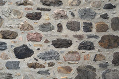 Stone and concrete wall, color rocks fieldstone texture background. Stone wall fieldstone and concrete natural building texture Royalty Free Stock Photo
