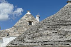Stone coned rooves of trulli houses. In Alberobello, Puglia, Italy royalty free stock images