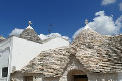 Stone coned rooves of trulli houses. In Alberobello, Puglia, Italy royalty free stock photos