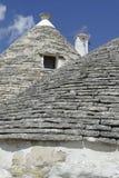 Stone coned rooves of trulli houses. In Alberobello, Puglia, Italy stock photo