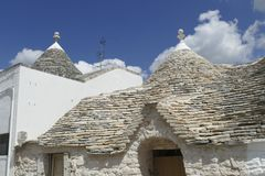Stone coned rooves of trulli houses. In Alberobello, Puglia, Italy royalty free stock photography