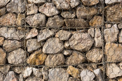 Stone construction with steel mesh which was dam embankment eros. Ion Royalty Free Stock Images