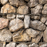 Stone construction with steel mesh which was dam embankment eros. Ion Stock Photos