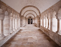 Stone Corridor. Travertine hallway with arch in the monastery Royalty Free Stock Image