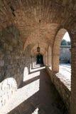 Stone Corridor. A stone corridor leading one around a courtyard Royalty Free Stock Photos
