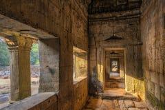 Stone Corridor. Corridor in ancient temple ruins of Ta Phrom, Cambodia Stock Photo