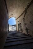 Stone corridor with stairway in Palazzo Pitti, Florence, Italy Stock Image