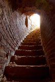 Stone corridor with stairway in tower Royalty Free Stock Image